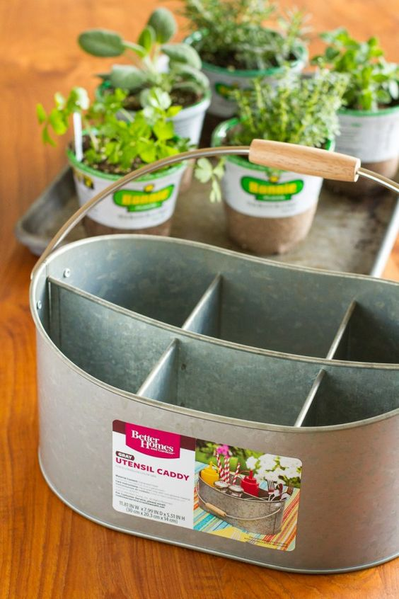 A farmhouse style utencil caddy can be used for different herbs  #indoorHerbGarden #indoorGardenIdeas #indoorgardendesigns #indoorgardenapartment #apartmentindoorgarden #apartmentgardening