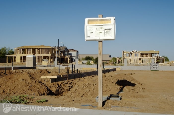 Building permit sign in a residential home construction site.
