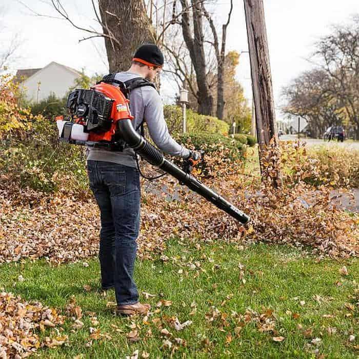 A man using an echo leaf blower