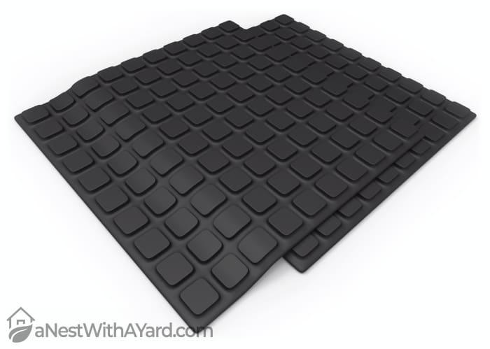 A set of black rubber mats