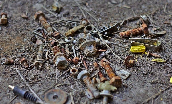 Dirt, debris and loose rusting screws