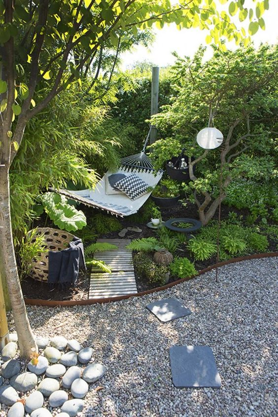 A relaxing spot with a hammock in the backyard garden  #smallGarden #SmallGardenDesign #smallyardlandscaping #gardenIdeas #backyardLandscaping #backyardLandscapingIdeas #landscaping