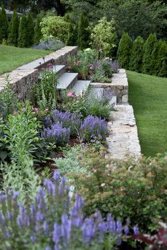 A small garden with flowers on a slope  #smallGarden #SmallGardenDesign #smallyardlandscaping #gardenIdeas #backyardLandscaping #backyardLandscapingIdeas #landscaping