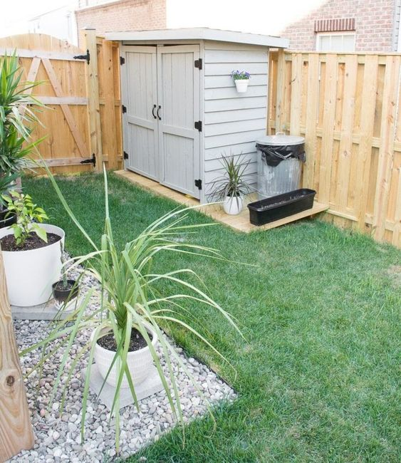 a small garden with a shed in landscape  #smallGarden #SmallGardenDesign #smallyardlandscaping #gardenIdeas #backyardLandscaping #backyardLandscapingIdeas #landscaping