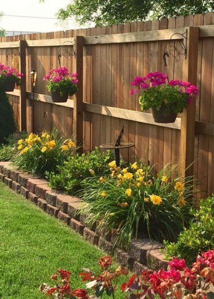 A small flower garden hanging from a fence  #smallGarden #SmallGardenDesign #smallyardlandscaping #gardenIdeas #backyardLandscaping #backyardLandscapingIdeas #landscaping