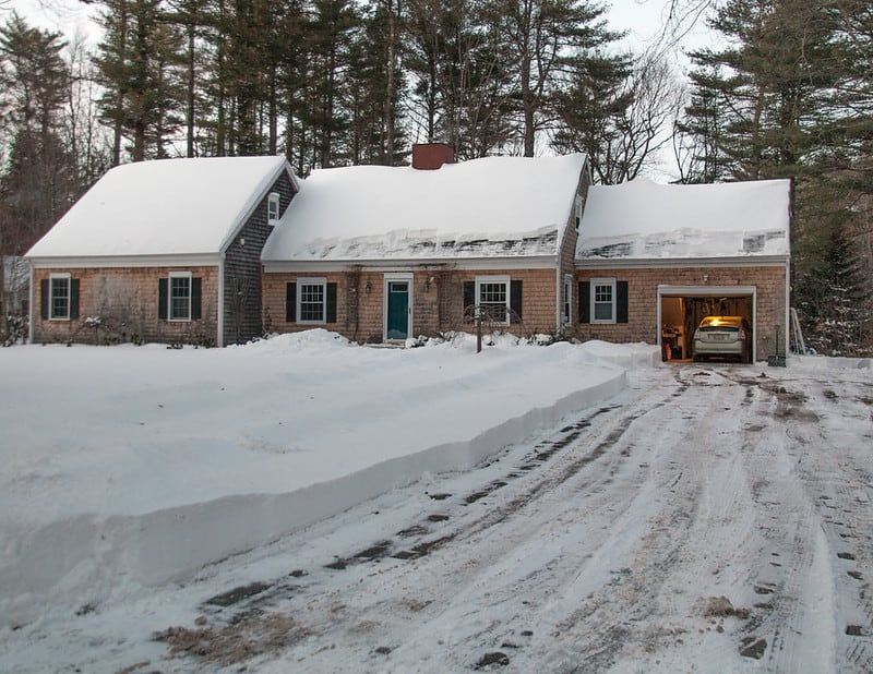 Clearing snow from a driveway with gravel