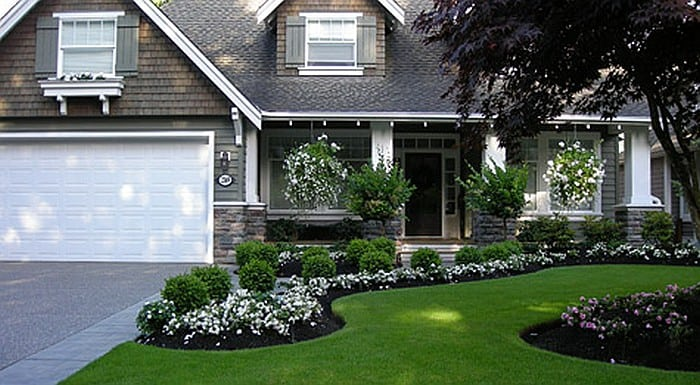 front yard with a beautiful manicured lawn